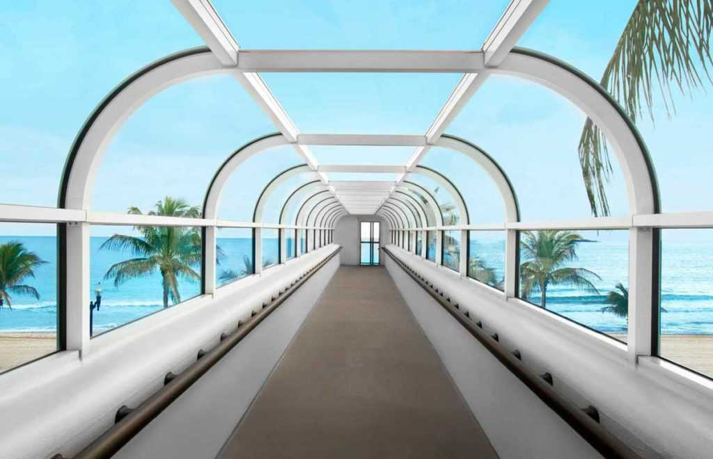 a wide open skywalk with windows opened to see the sky
