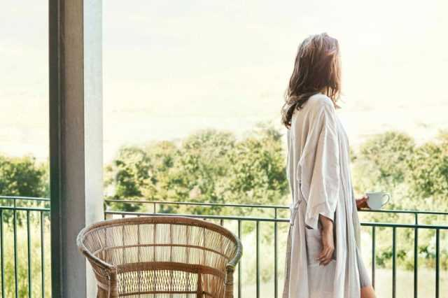 a woman overlooking balcony views in her robe