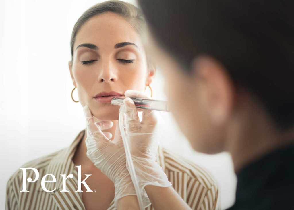 a perk lip technician working on the lips of a woman