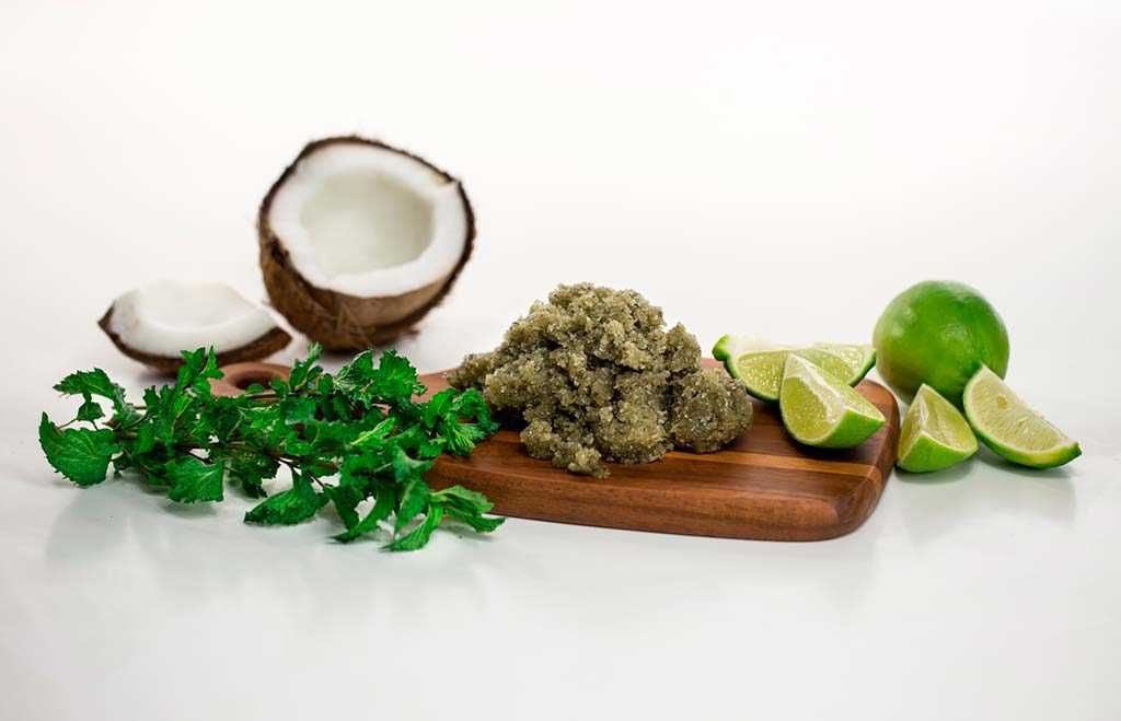 coconut, lime, and mint on a wooden cutting board