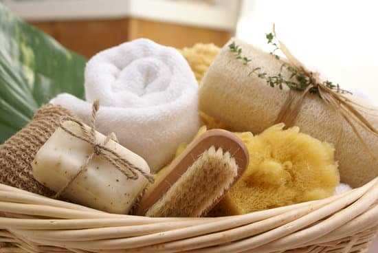 a spa gift basket with soaps, cloths, and a scrubbing brush