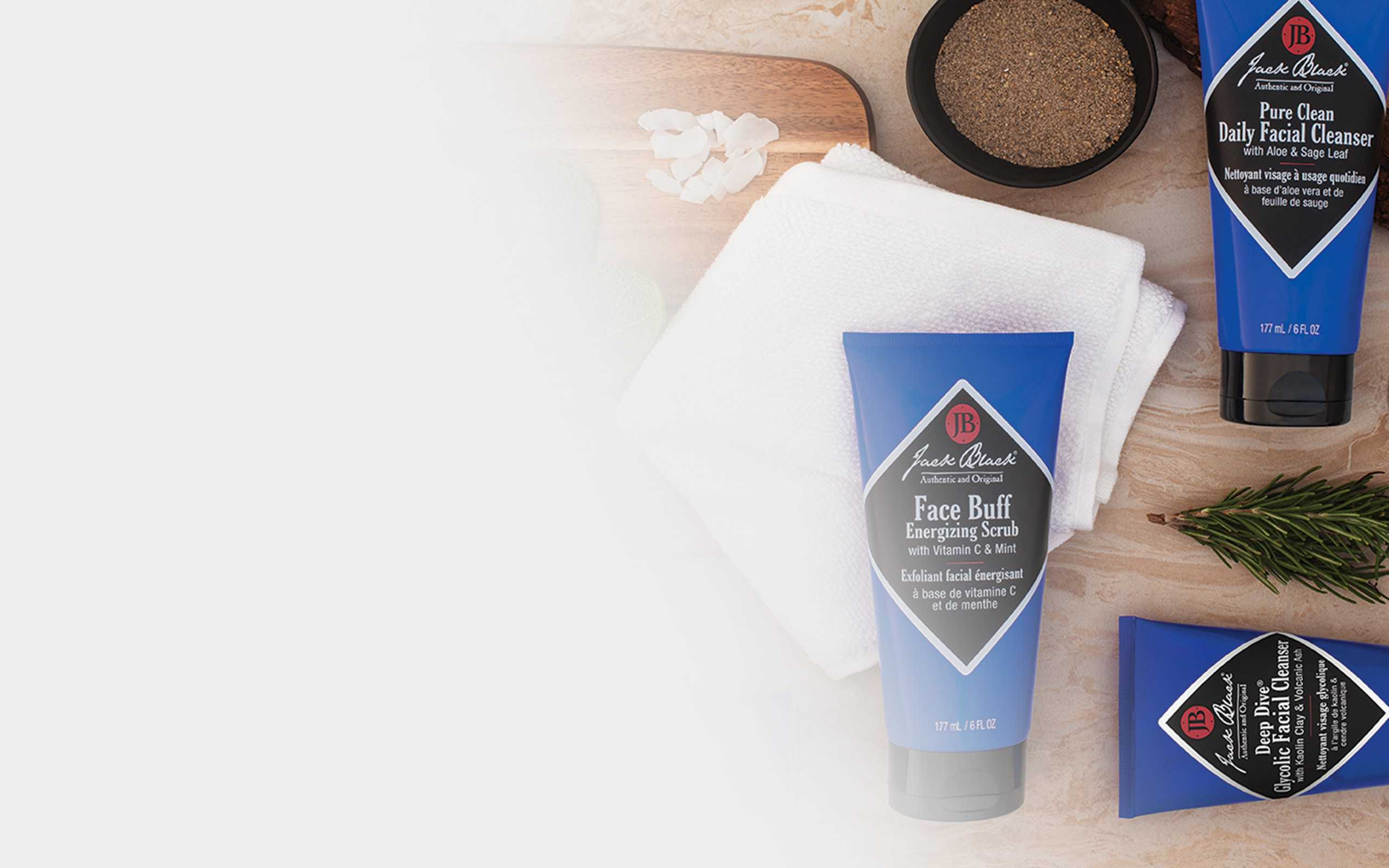 jack black spa products arranged on t able with leaves and wood boards